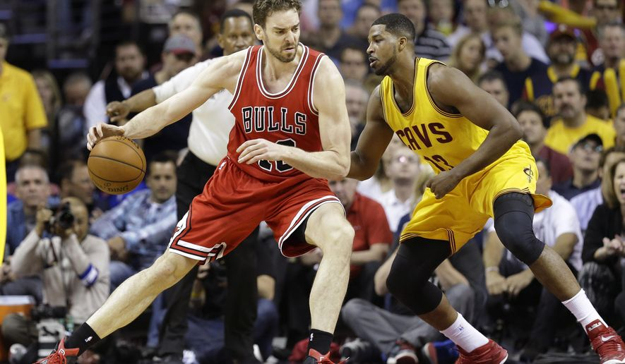 Chicago Bulls forward Pau Gasol (16) drives against Cleveland Cavaliers center Tristan Thompson (13) during the first half of Game 2 in a second-round NBA basketball playoff series Wednesday, May 6, 2015, in Cleveland. (AP Photo/Tony Dejak)