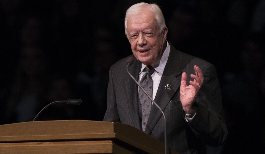 Former President Jimmy Carter speaks during the memorial service for Rev. Theodore Hesburgh, inside the Purcell Pavilion at the University of Notre Dame in South Bend, Ind., on March 4, 2015. Carter Center officials said Sunday, May 10, 2015, that Mr. Carter, 90, cut short an election observation visit in Guyana due to health reasons. (AP Photo/Robert Franklin, File)