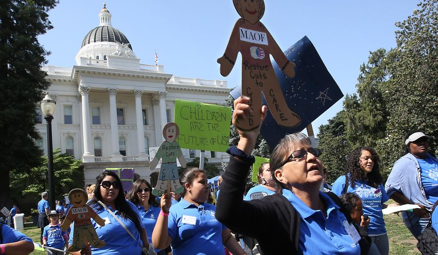 In this photo taken Wednesday May 6, 2015, hundreds calling for more funding for child care programs rallied at the Capitol in Sacramento, Calif. Gov. Jerry Brown will unveil his revised state budget this week as Democrats jockey to spend some of the growing $3 billion surplus on child care, higher education and other social programs.(AP Photo/Rich Pedroncelli)