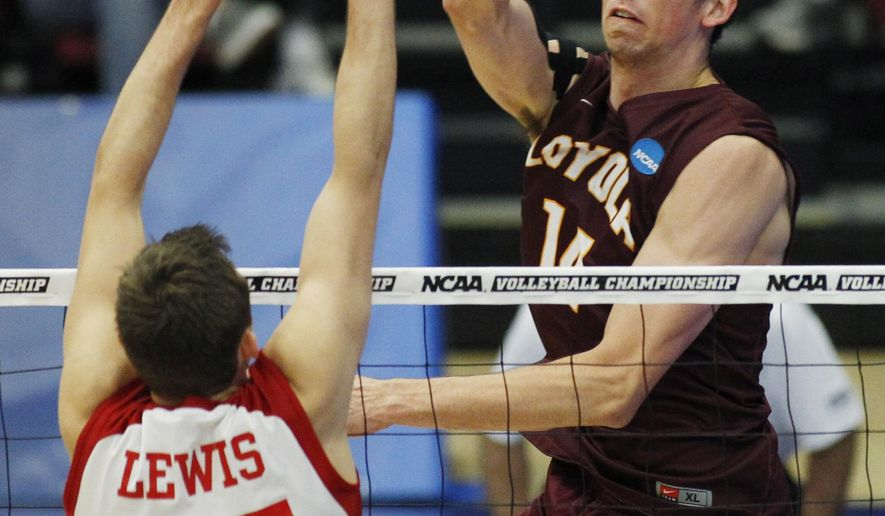 Loyola Chicago's Ricky Gevis, right, hits the ball as Lewis' Scott Fifer defends during the NCAA men's volleyball championship match, Saturday, May 9, 2015, in Stanford, Calif. (AP Photo/George Nikitin)