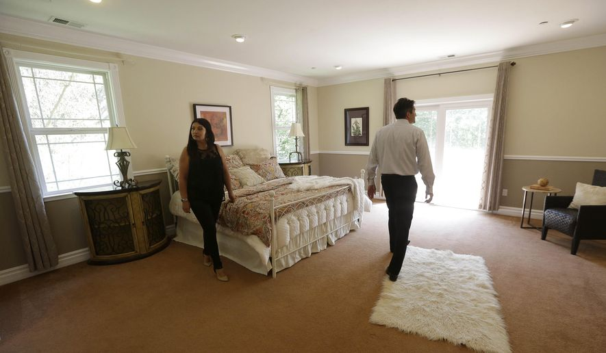 In this May 6, 2015 photo, realtor Stephan Marshall, right, walks with potential buyer Sasha Martinez at a home for sale on Perez Drive in Pacifica, Calif. Among the toughest markets for homebuyers are San Jose, San Francisco and Los Angeles, as well as Seattle, Denver, Dallas-Fort Worth, Texas, Nashville and Boston, according to Zillow. In those areas, homes are selling an average of 48 days faster than properties in markets where buyers have the edge, according to Zillow. (AP Photo/Jeff Chiu)