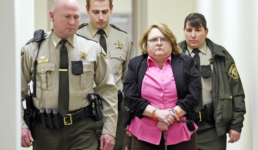 FILE - In this March 20, 2015, file photo, Joyce Hardin Garrard is led back to the Etowah County Detention Center in Gadsden, Ala. The Alabama woman convicted of running her 9-year-old granddaughter to death as punishment for lying about candy was sentenced Monday, May 11, 2015, to life in prison without the possibility of parole. (Eric T. Wright/The Gadsden Times via AP, File)