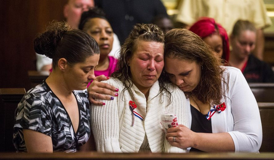 CORRECTS SENTENCE HANDED DOWN TO 22 TO 40 YEARS, NOT 44 YEARS - Clio resident Felicia Nagy, center, weeps as she listens to the sentencing of Flint resident Peris Andre Dorsette in the beating death of her father, slain homeless man Gary Nagy, as she is consoled by friends Staci Damon, left, and Trisha Miner, right, on Monday, May 11, 2015 at Genesee County Circuit Court in Flint. Genesee Circuit Judge Archie L. Hayman sentenced Dorsette to serve 22 to 40 years in prison on second degree murder and torture charges.  (Jake May/The Flint Journal-MLive.com via AP) LOCAL TELEVISION OUT; LOCAL INTERNET OUT