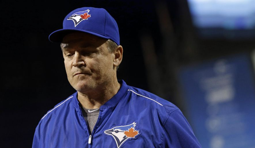 Toronto Blue Jays manager John Gibbons walks off the field after relieving pitcher Jeff Francis in the sixth inning of a baseball game against the Baltimore Orioles, Monday, May 11, 2015, in Baltimore. (AP Photo/Patrick Semansky)