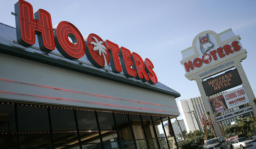 FILE - This Feb. 1, 2006 file photo Hooters hotel-casino, located one block from the Las Vegas Strip, is seen in Las Vegas. A real estate broker representing the owners of the Hooters Casino Hotel says the near-Strip property has sold for about $70 million to a New York-based hotel investment company. (AP Photo/Jae C. Hong,File)