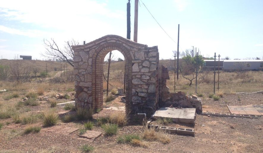 This stone archway at Stoney Glan Drive and Broadway Street is all that remains of a residence near Lake Meredith, Texas where a couple once lived before the fires of May 2014. Fire officials said 225 homes and 143 outbuildings were destroyed outright, but firefighters from the region and even New Mexico and Oklahoma helped save some 241 homes and 133 outbuildings. The cause of the fire still has not been publicly released. (Jim McBride/The Amarillo Globe News via AP)