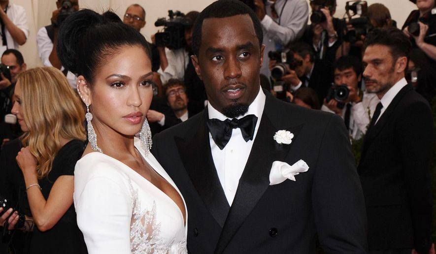 "FILE - In this May 4, 2015 file photo, Cassie, left, and Sean ""Diddy"" Combs arrive at The Metropolitan Museum of Art's Costume Institute benefit gala celebrating ""China: Through the Looking Glass"" in New York. Forbes recently named him the wealthiest hip-hop artist, and his fragrances, his latest being 3AM, have earned him a couple of FiFi Awards. (Photo by Charles Sykes/Invision/AP, FIle)"