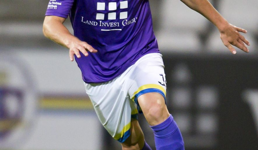 File - In this Aug. 16, 2014 file photo, Beerschot-Wilrijk player Tim Nicot kicks the ball during a match against KRC Gent Zeehaven in Antwerp, Belgium. A 23-year-old defender from a lower-league soccer club has become the second Belgian player to die of cardiac arrest in less than two weeks. Antwerp-based team Beerschot-Wilrijk says Tim Nicot died Monday, May 11, 2015 after collapsing during a match last week. He was taken to the Antwerp university hospital, where he had been kept in an artificial coma. In April, Gregory Mertens, a 24-year-old defender from Lokeren, also died from cardiac arrest during a reserve-team match. (AP Photo/Walter Saenen, File)