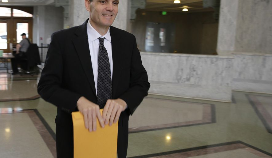 Washington state auditor Troy Kelley arrives at the federal courthouse in Tacoma, Wash., for a hearing Monday, May 11, 2015. Kelley is currently on unpaid leave after pleading not guilty in federal court to 10 felony counts, including allegations that he failed to pay taxes. (AP Photo/Ted S. Warren)