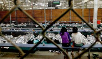 """A feared uptick in the number of illegal border-crossers coming into the U.S. from Mexico has so far failed to materialize, thanks largely to campaigns to refute the myth of """"permisos"""" granting crossers a free pass to remain in the United States. (Associated Press)"""