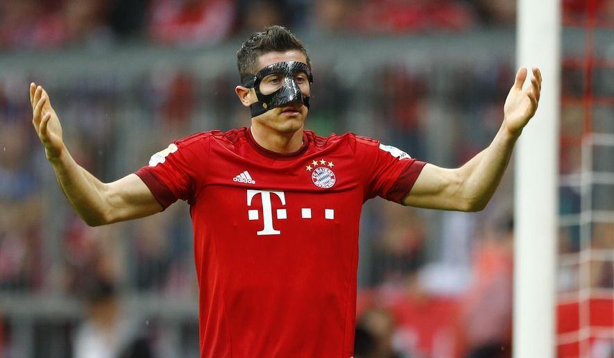 Bayern's Robert Lewandowski from Poland gestures during the German first division Bundesliga soccer match between FC Bayern Munich and FC Augsburg at the Allianz Arena in Munich, Germany, on Saturday, May 9, 2015. Lewandowski wears a mask due to face injuries. (AP Photo/Matthias Schrader)