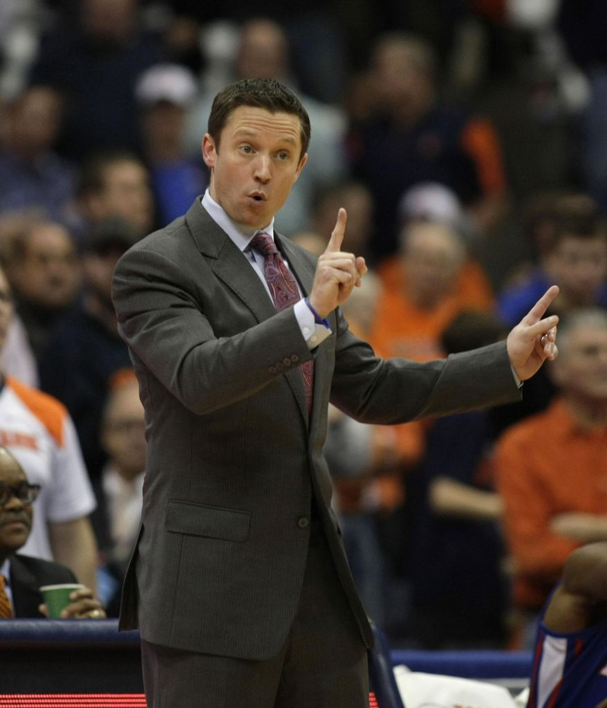 File- This Dec. 14, 2014, file photo shows Louisiana Tech head coach Michael White signaling to his players in the second half of an NCAA college basketball game against Syracuse in Syracuse, N.Y. The Florida Gators hired Louisiana Tech's White on Thursday, May 7, 2015, a week after Billy Donovan left to take the head coaching job with the NBA's Oklahoma City Thunder. (AP Photo/Nick Lisi, File)