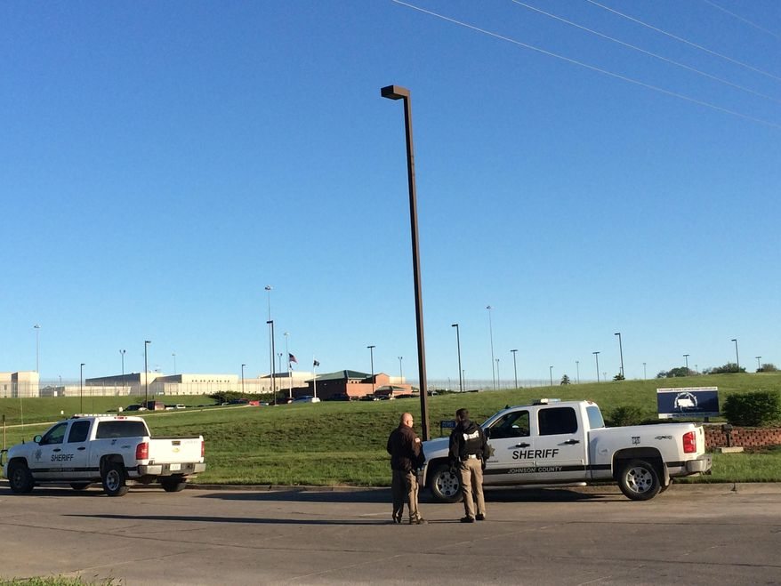 Members of the Johnson County Sheriff's Department stand outside the the Tecumseh State Correctional Institution Monday, May 11, 2015, in Tecomseh, Neb. Inmates at the maximum security prison in southeastern Nebraska have taken control of at least part of the facility in an incident that left two staff members and two prisoners injured, according to the state Department of Correctional Services. The incident started around 2:30 p.m. Sunday at the Tecumseh State Correctional Institution when staff members attempted to break up a large gathering of inmates in front of a housing unit, James Foster, a department spokesman, said in a statement. There was no indication early Monday that authorities have resumed full control at the facility that houses 11 death row inmates, and there were no reports of any escapes. (AP Photo/Anna Gronewold)
