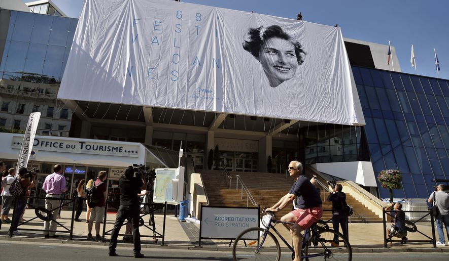 Workers place a banner depicting actress Ingrid Bergman on the Palais during preparations for the 68th international film festival in Cannes, southern France, Monday, May 11, 2015. The festival runs from May 13 to May 24. (AP Photo/Thibault Camus)