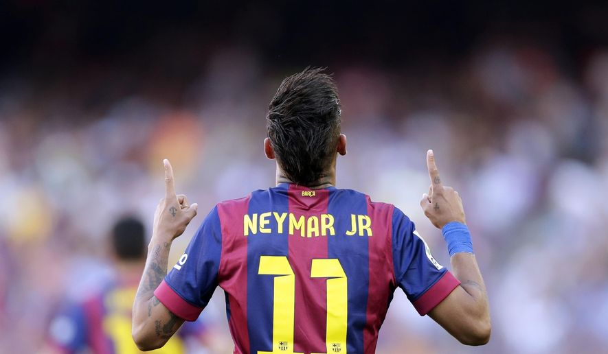 FILE - In this Saturday, May 9, 2015 file photo FC Barcelona's Neymar celebrates after scoring against Real Sociedad during a Spanish La Liga soccer match at the Camp Nou stadium in Barcelona, Spain. (AP Photo/Manu Fernandez, File)