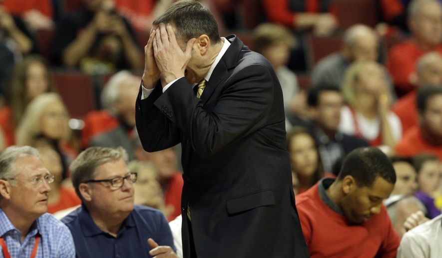 In this May 10, 2015, photo, Cleveland Cavaliers head coach David Blatt reacts as he watches his team during the second half of Game 4 of an Eastern Conference semifinal game in the NBA basketball playoff series against the Chicago Bulls in Chicago. An international coaching legend, Blatt's first season with the Cavaliers has been challenging, and he's under more heat after two puzzling decisions in Sunday's Game 4 win at Chicago. (AP Photo/Nam Y. Huh)