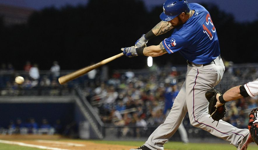 Texas Rangers' Josh Hamilton grounds out to Nashville Sounds shortstop Nanser Alberto in the third inning during a baseball game on Monday, May 11, 2015, in Nashville, Tenn. Hamilton is playing for the Round Rock Express AAA minor league baseball team before rejoining the Rangers after a rehab stint. (AP Photo/Mark Zaleski)