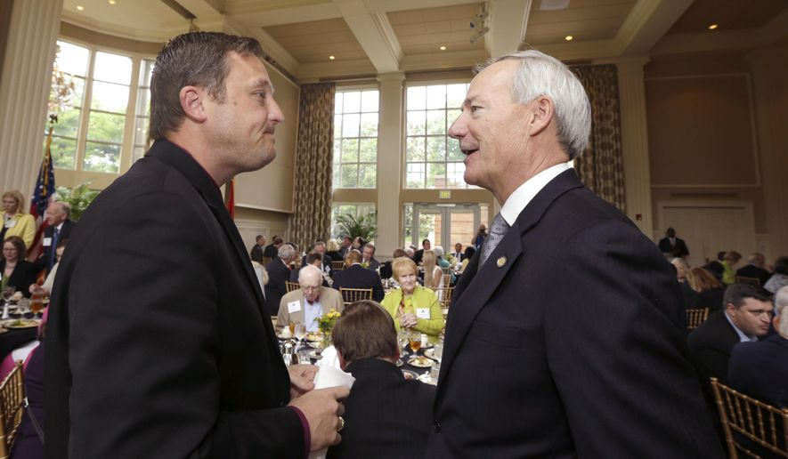 Arkansas Gov. Asa Hutchinson, right, speaks with Arkansas House Speaker Jeremy Gillam, R-Judsonia, during a meeting of the Political Animals Club at the Governor's Mansion in Little Rock, Ark., Monday, May 11, 2015. Hutchinson on Monday announced he will call a special legislative session starting May 26 to consider an incentive package aimed at luring a defense contract to the state. (AP Photo/Danny Johnston)
