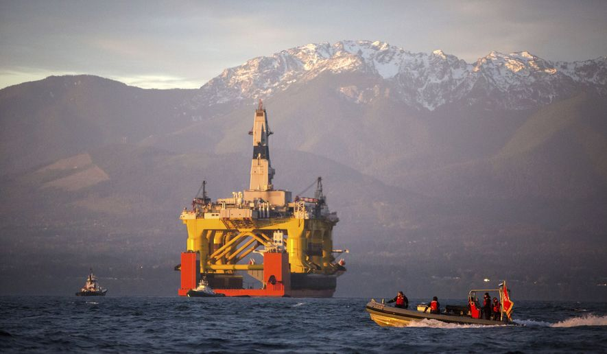 FILE - In this April 17, 2015 file photo, with the Olympic Mountains in the background, a small boat crosses in front of an oil drilling rig as it arrives in Port Angeles, Wash. aboard a transport ship after traveling across the Pacific. Royal Dutch Shell hopes to use the rig for exploratory drilling during the summer open-water season in the Chukchi Sea off Alaska's northwest coast, if it can get the permits. Royal Dutch Shell cleared a major hurdle Monday, May 11, 2015, when The Bureau of Ocean Energy Management approved Shell's exploration plan. However, this isn't the final step that Shell needs for Arctic drilling. (Daniella Beccaria/seattlepi.com via AP, File) MAGS OUT; NO SALES; SEATTLE TIMES OUT; TV OUT; MANDATORY CREDIT
