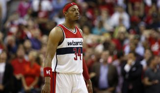 Washington Wizards forward Paul Pierce (34) reacts after missing a 3-point shot late in the second half of Game 4 of the second round of the NBA basketball playoffs against the Atlanta Hawks, Monday, May 11, 2015, in Washington. The Hawks won 106-101. (AP Photo/Alex Brandon)