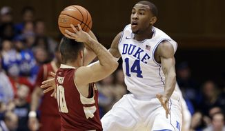 "FILE - In this Jan. 3, 2015, file photo, Duke's Rasheed Sulaimon (14) guards Boston College's Steve Perpiglia during an NCAA college basketball game in Durham, N.C. Former Duke guard Rasheed Sulaimon will play his final season at Maryland. Coach Mark Turgeon announced the addition of Sulaimon on Monday, May 11, 2015, . The Houston native said on Twitter that he is ""blessed and honored for the opportunity.""(AP Photo/Gerry Broome, File)"