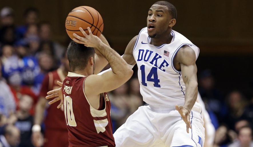 """FILE - In this Jan. 3, 2015, file photo, Duke's Rasheed Sulaimon (14) guards Boston College's Steve Perpiglia during an NCAA college basketball game in Durham, N.C. Former Duke guard Rasheed Sulaimon will play his final season at Maryland. Coach Mark Turgeon announced the addition of Sulaimon on Monday, May 11, 2015, . The Houston native said on Twitter that he is """"blessed and honored for the opportunity.""""(AP Photo/Gerry Broome, File)"""