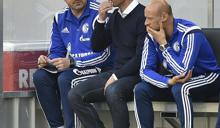 Schalke's head coach Roberto di Matteo from Italy, center, watches from the bench with his assistants during the German Bundesliga soccer match between 1. FC Cologne and FC Schalke 04 in Cologne, Germany, Sunday, May 10, 2015.  Cologne defeated Schalke with 1-0. (AP Photo/Martin Meissner)