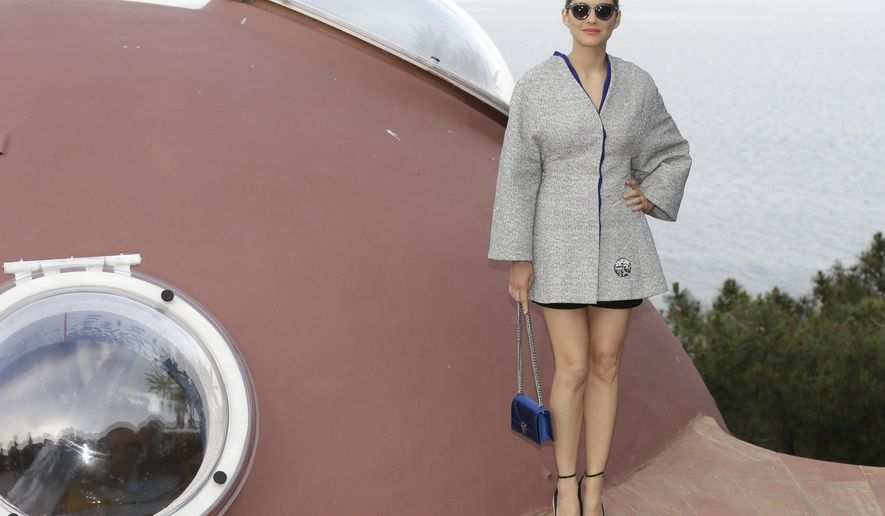 French actress Marion Cotillard arrives at the Dior Resort 2015 catwalk show presented in Cannes, southeastern France, Monday, May 11, 2015. (AP Photo/Lionel Cironneau)