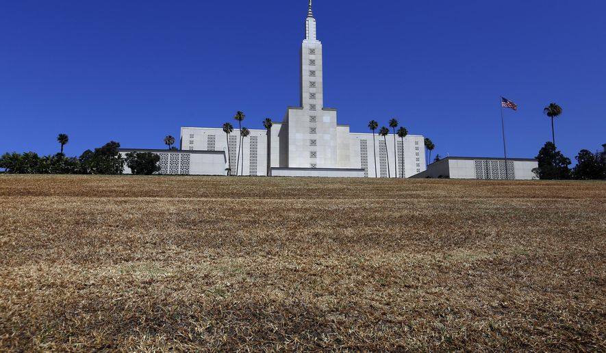 In this Sunday, May 10, 2015 photo, the grass has turned brown in front of The Los Angeles California Temple on Santa Monica Boulevard in Westwood, Calif. California's first Mormon temple is letting its lawn go brown as drought concerns have water users tightening their consumption statewide. (Francine Orr/Los Angeles Times via AP)  NO FORNS; NO SALES; MAGS OUT; ORANGE COUNTY REGISTER OUT; LOS ANGELES DAILY NEWS OUT; INLAND VALLEY DAILY BULLETIN OUT; MANDATORY CREDIT, TV OUT