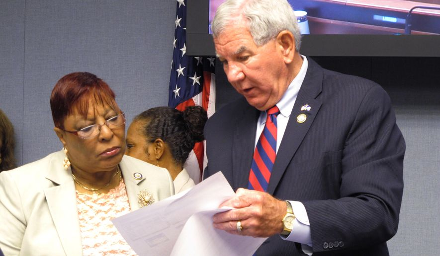 Rep. Patricia Smith, D-Baton Rouge, left, looks over budget amendments with Appropriations Committee Chairman Jim Fannin, R-Jonesboro, before the committee made its changes to next year's spending plans, on Monday, May 11, 2015, in Baton Rouge, La. (AP Photo/Melinda Deslatte)
