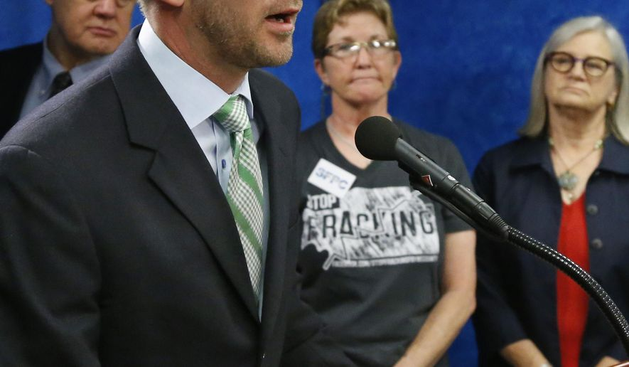 Oklahoma state Rep. Corey Williams, D-Stillwater, speaks at a news conference in Oklahoma City, Monday, May 11, 2015. A coalition of environmental and grassroots organizations is calling for a moratorium on the use of wastewater disposal wells by the oil and natural gas industry in areas where they may trigger earthquakes. (AP Photo/Sue Ogrocki)