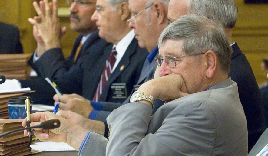 Rep. Ron Ryckman, Sr., R-Meade, front and other members of the House Tax committee listened Monday, May 11, 2015, as J. G. Scott,  Assistant Director for Fiscal Affairs for Kansas Legislative Research gave an overview of the revenue projections for the upcoming physical year. (Thad Allton/Topeka Capital-Journal via AP)