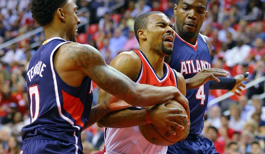 Atlanta Hawks Jeff Teague, left, and Paul Millsap, right, double team Washington Wizards' Ramon Sessions during the first half of Game 4 of the second round of the NBA basketball playoffs Monday, May 11, 2015, in Washington. (Curtis Compton/Atlanta Journal-Constitution via AP)  MARIETTA DAILY OUT; GWINNETT DAILY POST OUT; LOCAL TELEVISION OUT; WXIA-TV OUT; WGCL-TV OUT