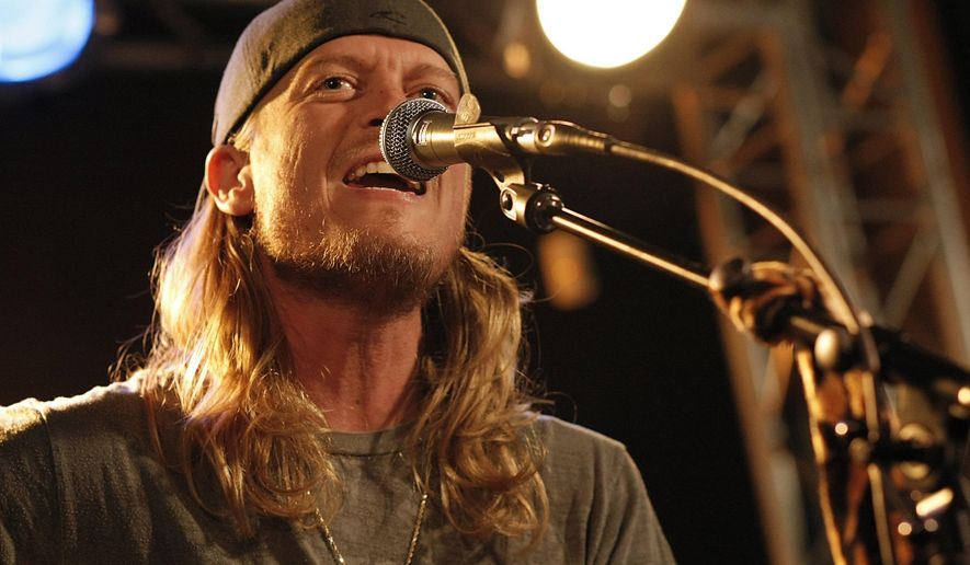 FILE - This Dec. 7, 2009 file photo shows Wes Scantlin of the band Puddle of Mudd performing at the Gibson Guitar Dusk Tiger launch party in Beverly Hills, Calif. Scantlin has missed a court date after being arrested for riding the oversized luggage carousel at the Denver International Airport last month. Scantlin was arrested by Denver police and charged with misdemeanor trespassing after taking his joy ride into an area that requires a security clearance for entrance. (AP Photo/Dan Steinberg,File)