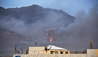 A Saudi-led airstrike hits a site believed to be a weapons cache in Yemen's capital, Sanaa, on Monday, May 11, 2015. (AP Photo/Hani Mohammed)