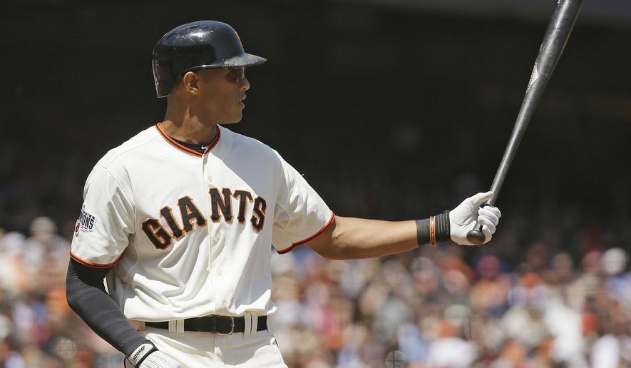 In this May 6, 2015, photo, San Francisco Giants' Justin Maxwell bats during a baseball game against the San Diego Padres in San Francisco. Journeyman Maxwell has proven a reliable replacement for injured Giants right fielder Hunter Pence. And he has had his wife and three children along for every moment of it, given that Loren Maxwell is home-schooling their oldest son for the second half of his kindergarten year so they can all stay together as a family. (AP Photo/Eric Risberg)