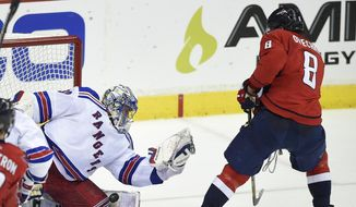 New York Rangers goalie Henrik Lundqvist (30), from Sweden, stops the puck against Washington Capitals left wing Alex Ovechkin (8), from Russia, during the third period of Game 6 in the second round of the NHL Stanley Cup hockey playoffs, Sunday, May 10, 2015, in Washington. The Rangers won 4-3. (AP Photo/Nick Wass)