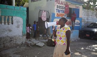 In this May 8, 2015, photo, volunteer Anne-Marie Saintou announces that only special needs children will be treated, or allowed to live at the Mercy & Sharing residential center, as she walks in the seaside community of Luly in Arcahaie, Haiti. (AP Photo/Dieu Nalio Chery)