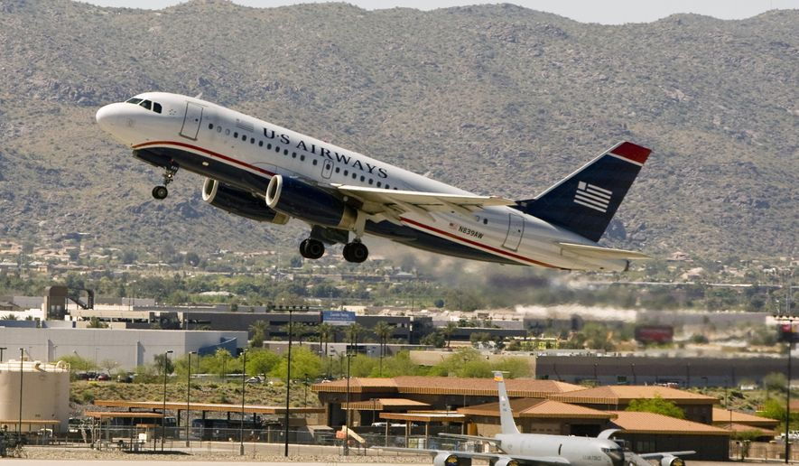 FILE - In this April 8, 2010 file photo, a US Airways plane takes off from Sky Harbor International Airport in Phoenix. American Airlines on Tuesday, May 12, 2015 said it plans to shut down the venerable carrier over a 90-day stretch that could begin as soon as July, which would mean a final departure around October. (Cheryl Evans/The Arizona Republic via AP)  MARICOPA COUNTY OUT; MAGS OUT; NO SALES