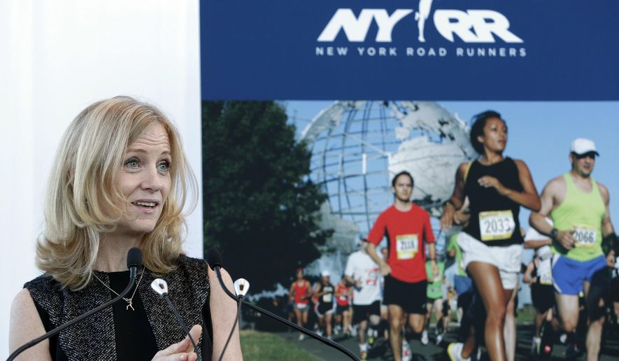 FILE - In this Oct. 30, 2014, file photo, New York Road Runners president Mary Wittenberg speaks during a news conference in New York. Wittenberg is stepping down as president and CEO of the New York Road Runner, the organization said, Tuesday, May 12, 2015. Wittenberg's two top deputies, Michael Capiraso and Peter Ciaccia, will take over its leadership. Wittenberg is becoming global CEO of a new lifestyle company, Virgin Sport. (AP Photo/Seth Wenig, File)