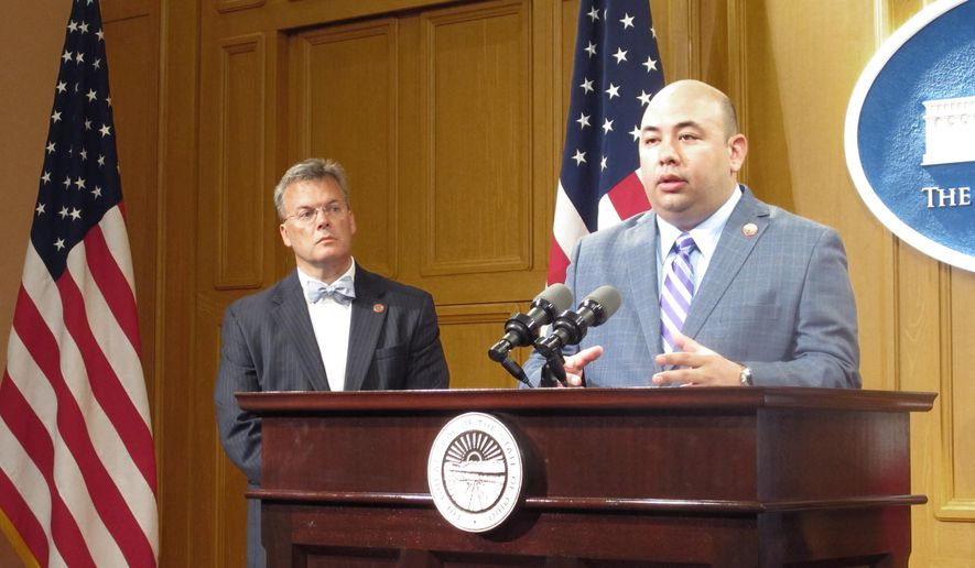 Ohio House Speaker Cliff Rosenberger, right, discusses legislation to boost the minimum number of training hours to become a police officer as Rep. Tim Derickson listens on Tuesday, May 12, 2015, in Columbus, Ohio.  Ohio would boost the amount of training to become a police officer and require all candidates for jobs in law enforcement to have a high school diploma under legislation announced at the Ohio Statehouse.  (AP Photo/Andrew Welsh-Huggins)