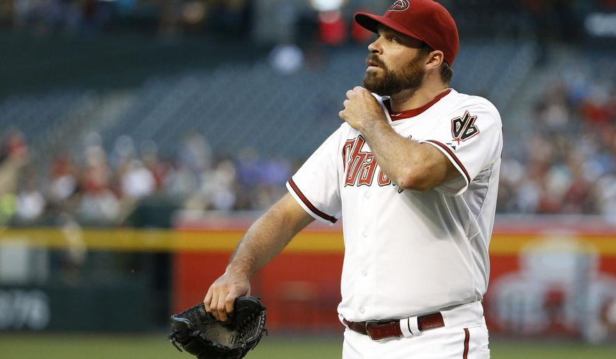 Arizona Diamondbacks' Josh Collmenter walks slowly off the field after giving up four runs to the Washington Nationals in the first inning of a baseball game Monday, May 11, 2015, in Phoenix. (AP Photo/Ross D. Franklin)