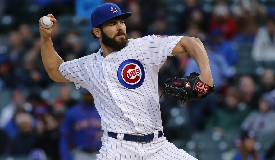 Chicago Cubs starting pitcher Jake Arrieta throws during the first inning of a baseball game against the New York Mets on Tuesday, May 12, 2015, in Chicago. (AP Photo/Charles Rex Arbogast)