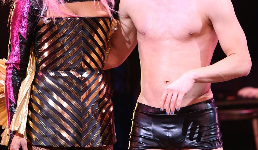 "FILE - In this April 29, 2015 file photo, Rebecca Naomi Jones, left, and Darren Criss appear on stage during the curtain call for his ""Hedwig and the Angry Inch"" debut performance at the Belasco Theatre in New York. (Photo by Greg Allen/Invision/AP, File)"