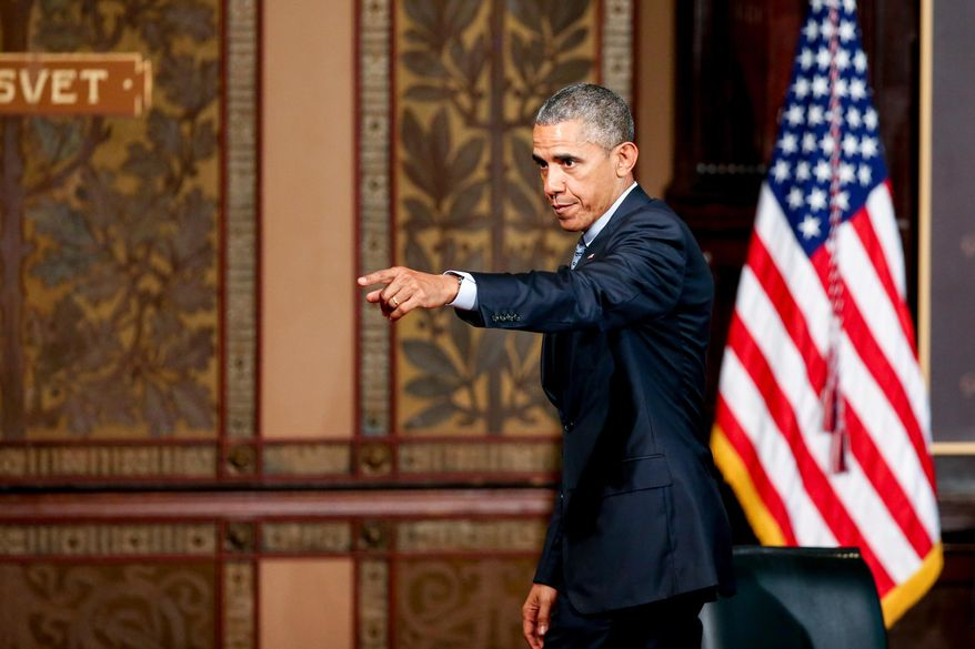 """President Barack Obama points to the audience as he departs after speaking at the Catholic-Evangelical Leadership Summit on Overcoming Poverty at Gaston Hall at Georgetown University in Washington, Tuesday, May 12, 2015.  The president said that """"it's a mistake"""" to think efforts to stamp out poverty have failed and the government is powerless to address it.  (AP Photo/Andrew Harnik)"""