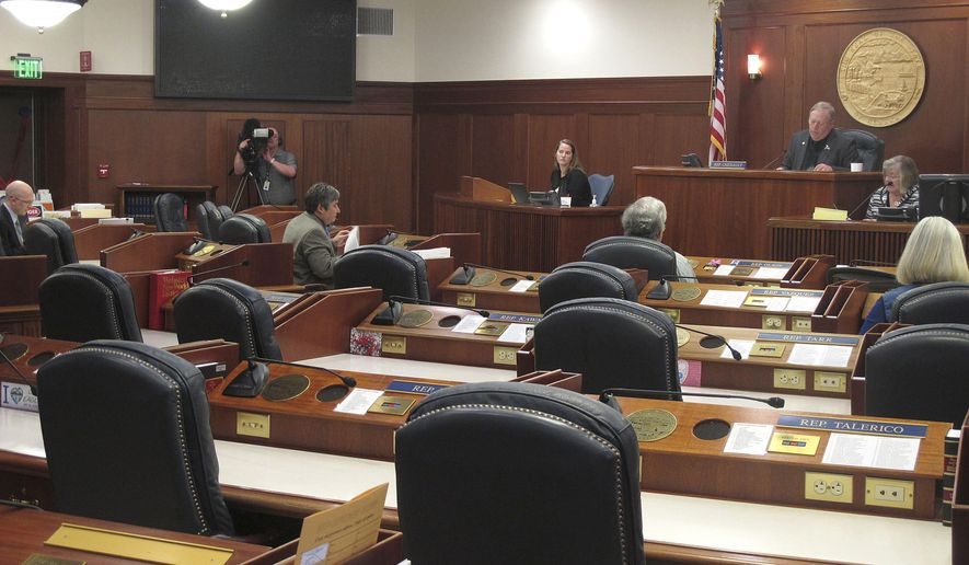 Six of the 40 House members attend a technical floor session Tuesday, May 12, 2015, at the Capitol in Juneau, Alaska. A quorum was not needed and attendance by all members was not required. Not shown is Rep. Dan Ortiz. (AP Photo/Becky Bohrer)
