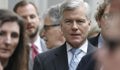 Former Virginia Gov. Bob McDonnell waits in line as he arrives at the 4th Circuit Court of Appeals for a hearing on the appeal of his corruption conviction, in Richmond on May 12, 2015. (Associated Press) **FILE**