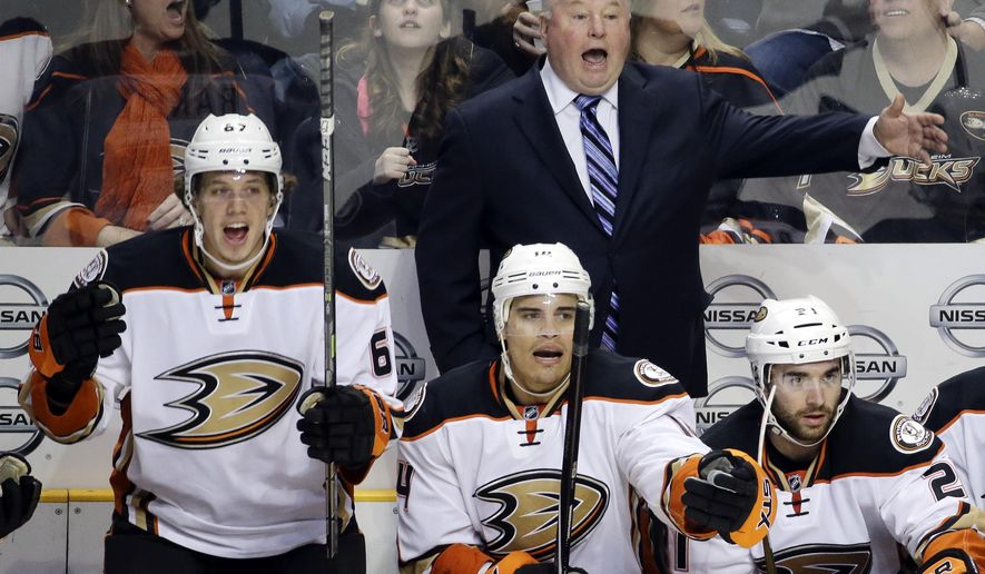 """FILE- In this Feb. 5, 2015, file photo, Anaheim Ducks head coach Bruce Boudreau, rear; Rickard Rakell (67), of Sweden; and Rene Bourque (14) yell for a penalty call in the second period of an NHL hockey game against the Nashville Predators in Nashville, Tenn. When the Ducks clinched  Boudreau's first trip to the Western Conference finals, the affable coach allowed himself """"five minutes of joy"""" to celebrate the death of his old reputation. His spectacular regular-season success will no longer be overshadowed by his teams' Stanley Cup playoff failures (AP Photo/Mark Humphrey, File)"""
