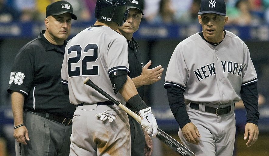 New York Yankees' Jacoby Ellsbury (22) and manager Joe Girardi, right, argue a call with umpires Eric Cooper (56) and Dan Iassogna, center, during the eighth inning of a baseball game Tuesday, May 12, 2015, in St. Petersburg, Fla. (AP Photo/Steve Nesius)