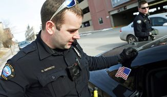 Duluth police officer Dan Merseth, (left) wears a body camera on the front of his uniform during his shift in Duluth, Minnesota. Outfitting cops with body cameras puts police departments in the precarious position of having to decide whether their officers need to keep their cameras on all the time or use them at their discretion, said New Mexico attorney Tom Grover. (Associated Press photographs)